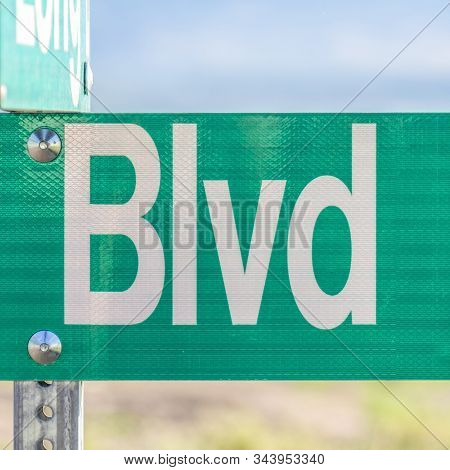 Square Frame Selective Focus On A Green And White Road Street Sign That Reads Blvd