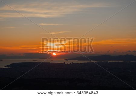 Sunset In Athens On A Cloudy Sky With A City View From Lycabettus Hill