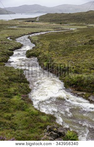 Allt Coire Nam Bruadaran River In Spate After Heavy Rain Flows Into Loch Ainort, Isle Of Skye, Weste