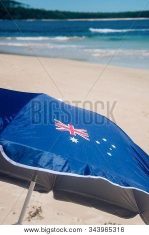 Asutralia Day And Immigration Concept Background: Patriotic Aussie Umbrella Featuring Australian Fla