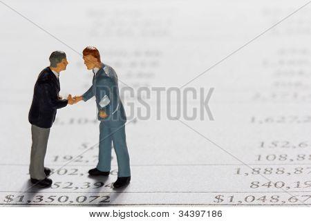 Miniature Businessmans On Report