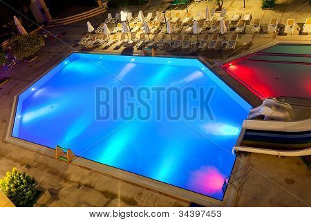 Illuminated Swimming Pool At Night