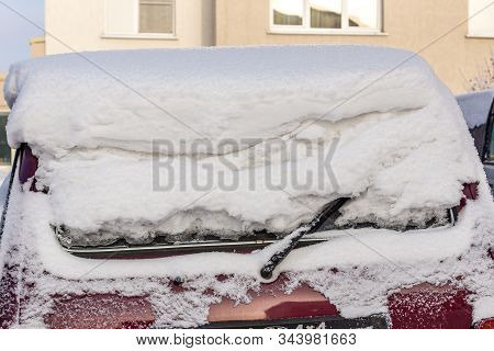 Car Rear Window Covered With A Large Layer Of Snow, Car Covered With Snow