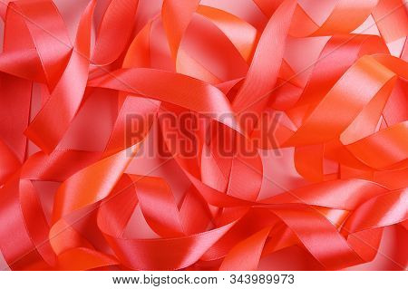 Silk Coral Pink Ribbons Top View Background. Bittersweet Color Satin Stripe Feminine Decoration From