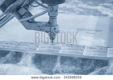The Abrasive Multi-axis  Water Jet Machine Cutting The Aluminium Plate With Lighting Effect. The Hi-