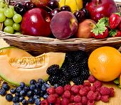 A delicious selection of fruit overflowing from a basket poster