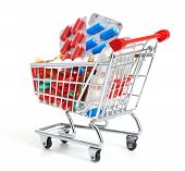Shopping trolley with pills and medicine isolated poster