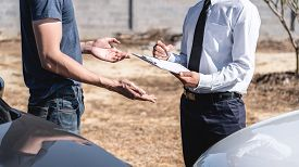 Insurance Agent And Customer Assessed Negotiation, Checking And Signing On Report Claim Form Process