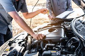 Technician Team Working Of Car Mechanic In Doing Auto Repair Service And Maintenance Worker Repairin