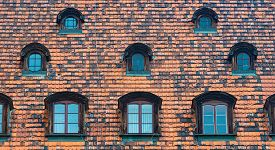 Tiled House Roof With Window In Wroclaw, Poland. Old Town Architecture Of Europe.