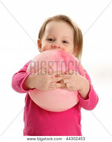 Little Girl Hugging A Ball