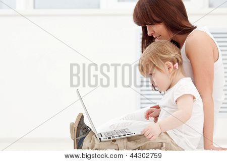Loving family looking at a laptop