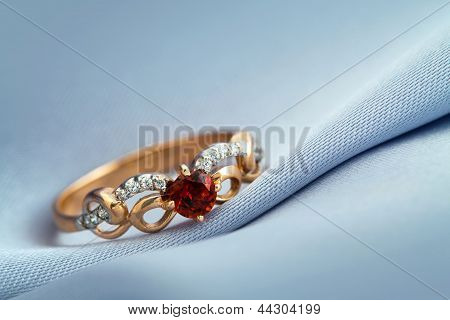 Ring With Ruby On Grey Background