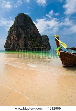 Tropical Beach Landscape. Thai Traditional Long Tail Boats At Ocean Gulf Under Blue Sky