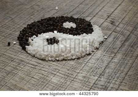 Seasalt And Peppercorns Yin Yang On Wooden Chopping Board