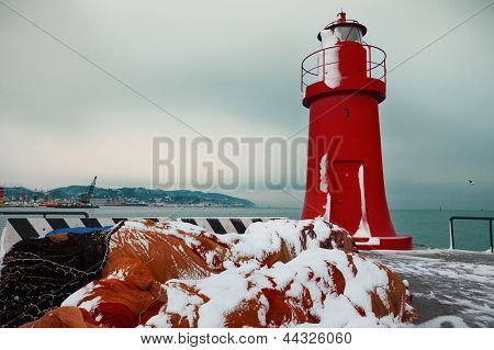 red lighthouse in winter, La Spezia harbor
