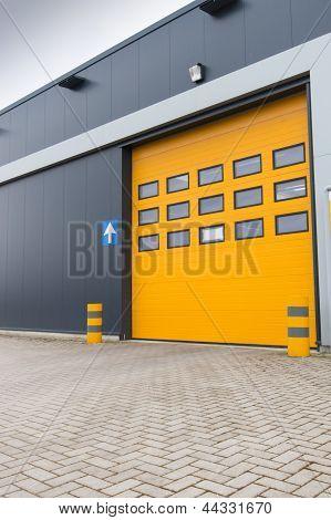 Yellow Loading Door In Industrial Warehouse