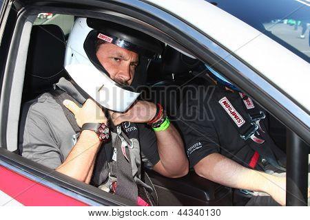 LOS ANGELES - APR 9:  Maksim Chmerkovskiy at the Toyota ProCeleb Race Press Day 2013 at the Toyoto Grand Prix Circuit on April 9, 2013 in Long Beach, CA