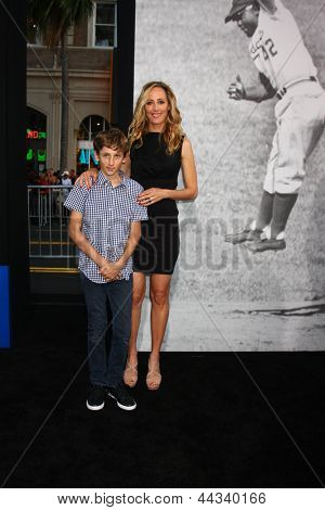 LOS ANGELES - APR 9:  Kim Raver, son arrives at the