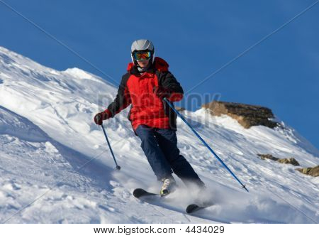 Skier In Red Jacket And In Goggles