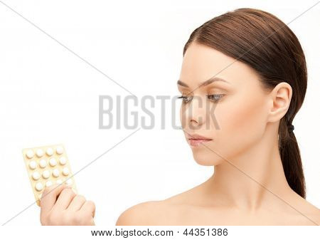 picture of sad young woman with pills