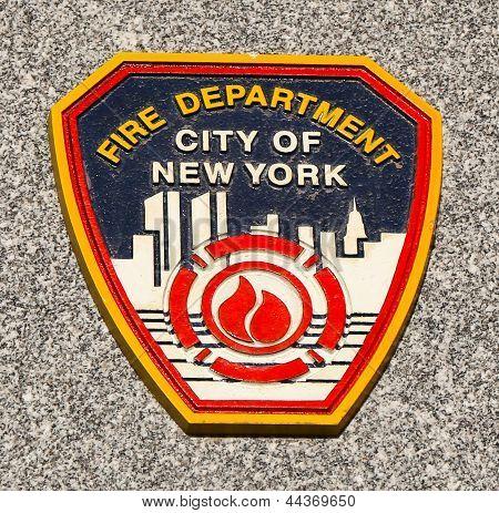 FDNY emblem on fallen officers memorial in Brooklyn, NY.