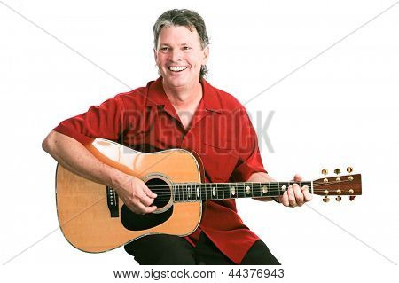 Handsome mature guitarist performing against a white background.