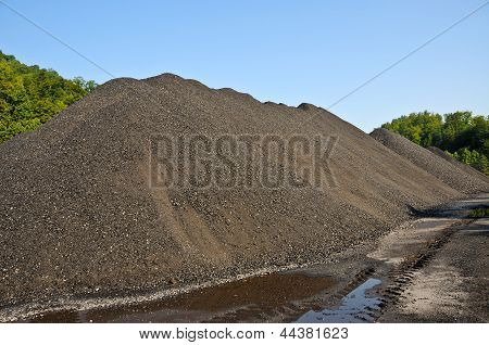 A Large Stock Pile of Coal on the Ground poster