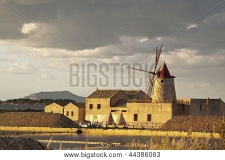 Windmill at sunset in the saltern near Marsala, Sicily