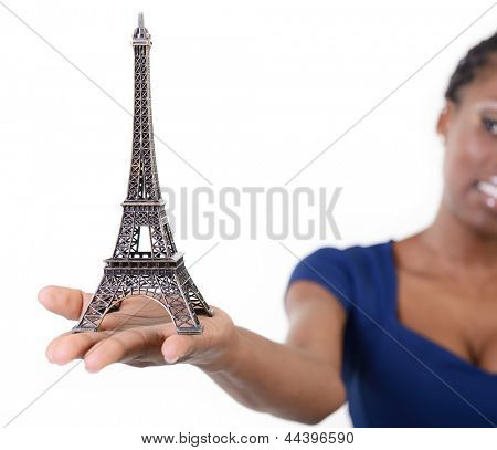 Eiffel tower - symbol of Paris - in hand of african model, over white
