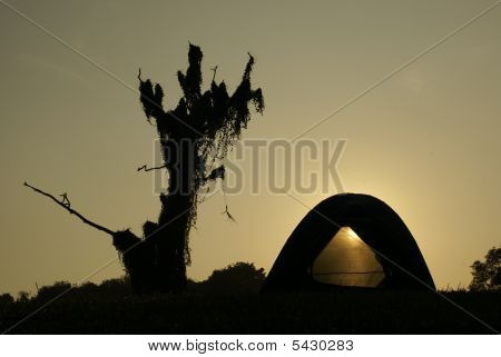 Camping Tent Outdoors With Sunrise Through Doorway
