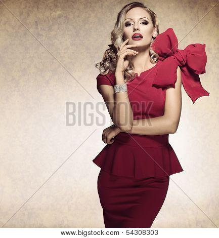 Arrogant Blond Sexy Girl. Red Dress