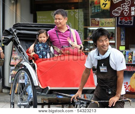 A Traditionaljapanese Rickshaw In Arashiyama District