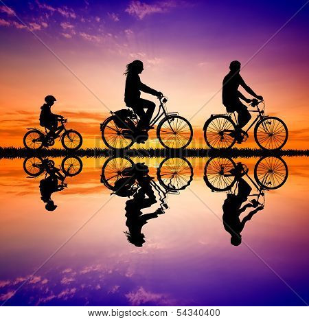 Biking Family At Sunset