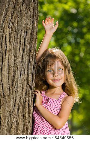 Pretty Little Girl Near A Tree