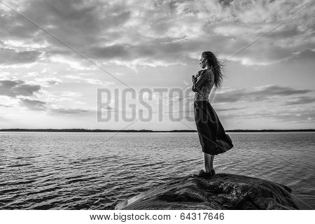 Woman Looks At The Horizon