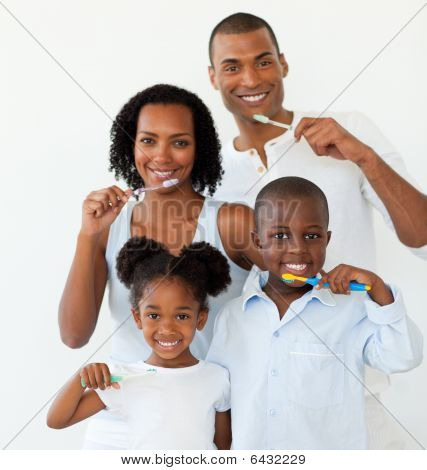 Afro-american Family Brushing Their Teeth