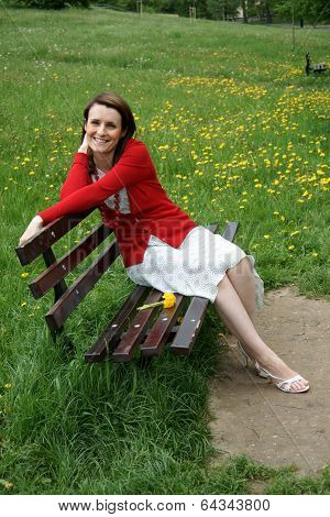 Happy woman sitting on bench