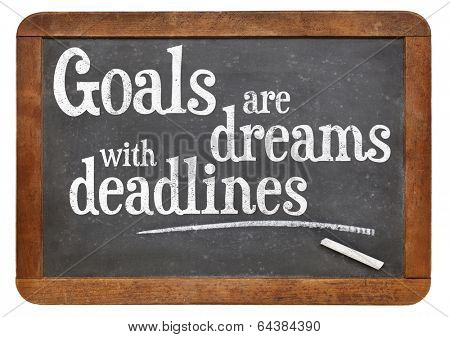 Goals are dreams with deadlines - motivational phrase on a vintage blackboard poster