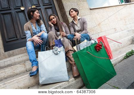 Happy Girls Messaging With Mobile Phone After Shopping