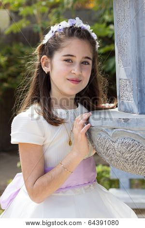 Young Girl Smiling In Her First Communion