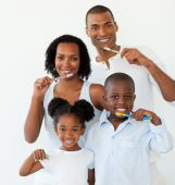 Afro-american family brushing their teeth in the bathroom poster
