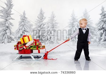 Little Boy Drags A Huge Heap Of Christmas Gifts