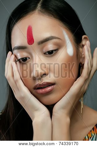 beauty young asian girl with make up like Pocahontas, red indians woman