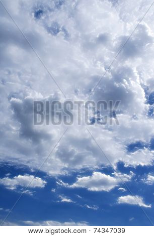 Cloudscape Of Fluffy Cloudy Blue Sky