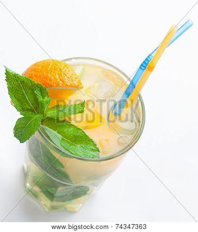 Glass Of Fresh Lemonade With Orange, Ice Cubes, Mint, Straws