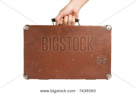 Hand Holding An Old Suitcase