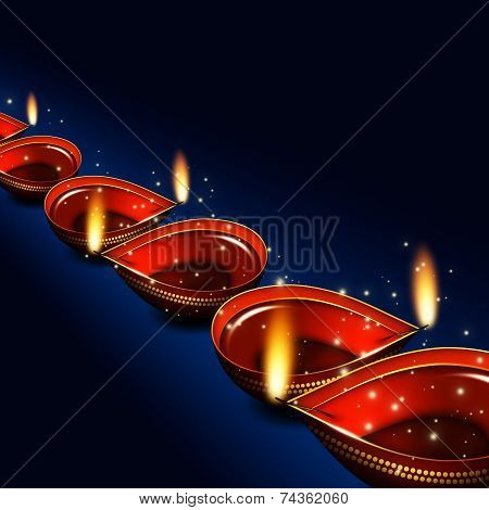 Diwali Oil Lamps Over Dark Blue Background