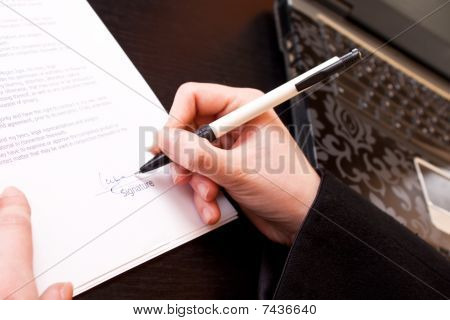 Signing A Business Document