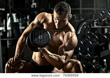 very power athletic guy bodybuilder execute exercise with dumbbells in dark gym poster
